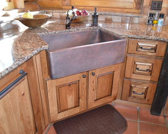 Ideas, Remodels & Photos with Beige Backsplash and Distressed Cabinets