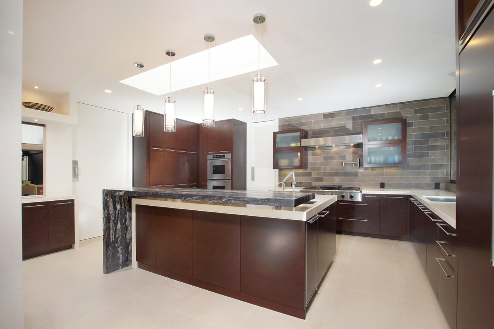 Kitchen - mid-sized modern u-shaped porcelain tile and beige floor kitchen idea in San Diego with a single-bowl sink, flat-panel cabinets, brown cabinets, quartz countertops, gray backsplash, porcelain backsplash, stainless steel appliances, an island and beige countertops