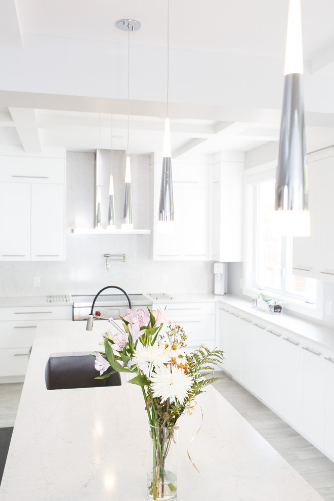 Kitchen - mid-sized contemporary u-shaped ceramic tile and gray floor kitchen idea in Ottawa with an undermount sink, flat-panel cabinets, white cabinets, quartz countertops, white backsplash, stainless steel appliances, an island and white countertops