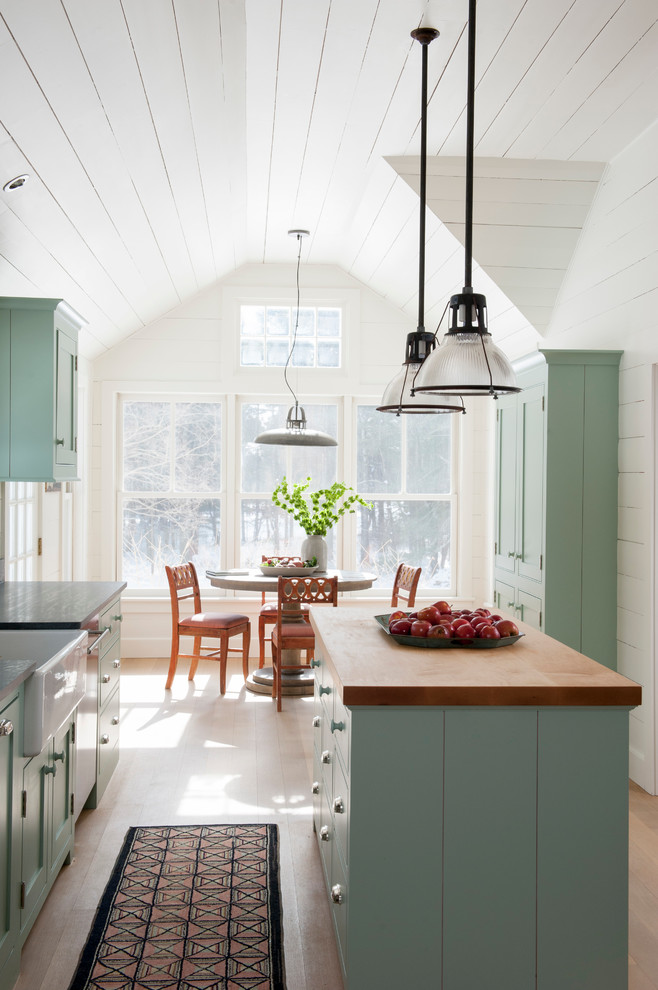 Eat-in kitchen - country eat-in kitchen idea in Bridgeport with a farmhouse sink, beaded inset cabinets, blue cabinets and wood countertops