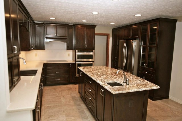 Trendy eat-in kitchen photo in Other with dark wood cabinets, granite countertops and stainless steel appliances
