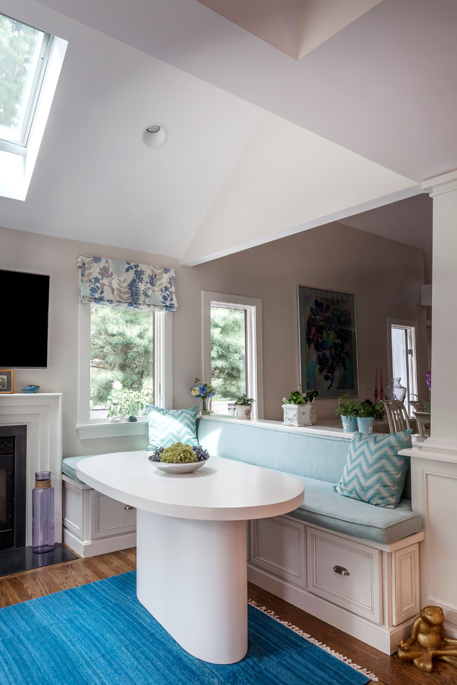 Example of a classic eat-in kitchen design in Boston with recessed-panel cabinets and white cabinets