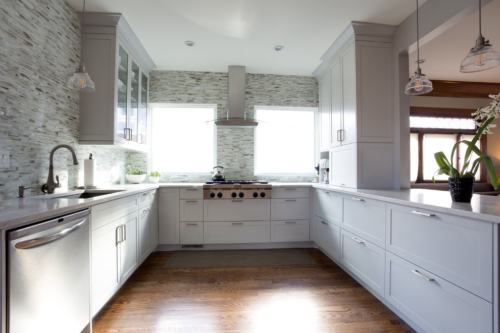 Inspiration for a mid-sized contemporary u-shaped enclosed kitchen remodel in Denver with shaker cabinets, white cabinets and a peninsula