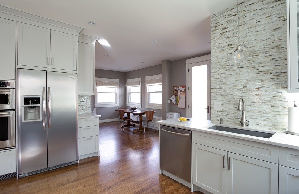 Mid-sized trendy u-shaped enclosed kitchen photo in Denver with shaker cabinets, white cabinets and a peninsula