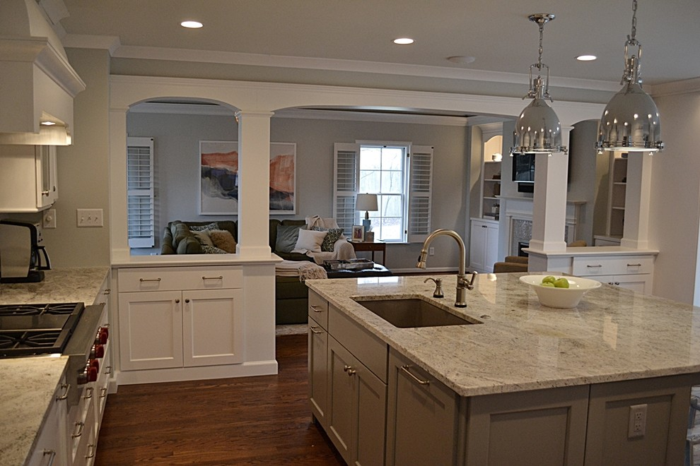 Enclosed kitchen - large traditional l-shaped dark wood floor and brown floor enclosed kitchen idea in St Louis with an undermount sink, shaker cabinets, white cabinets, granite countertops, stainless steel appliances, an island, gray backsplash and glass tile backsplash