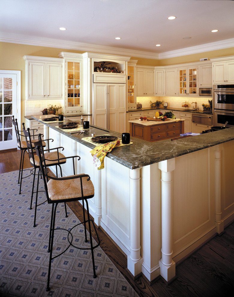 Eat-in kitchen - huge traditional l-shaped dark wood floor eat-in kitchen idea in DC Metro with an undermount sink, beaded inset cabinets, white cabinets, granite countertops, white backsplash, ceramic backsplash, stainless steel appliances and two islands