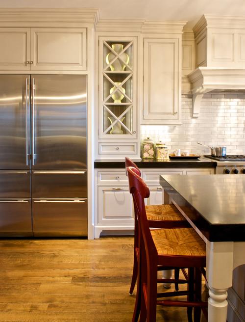 white kitchen with sub-zero refrigerator and island