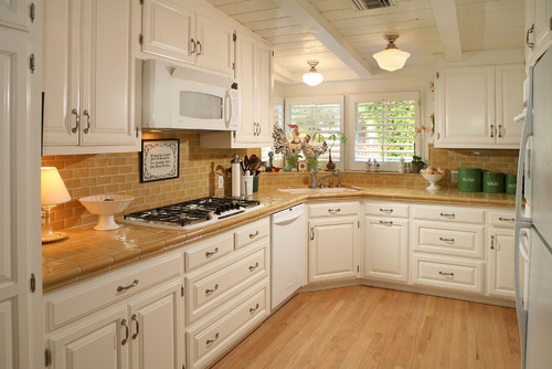 what granite would you suggest with ivory cabinets and cherry floors?