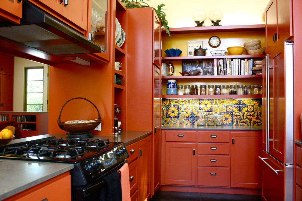 Southwest galley enclosed kitchen photo in Santa Barbara with open cabinets, orange cabinets, multicolored backsplash and paneled appliances