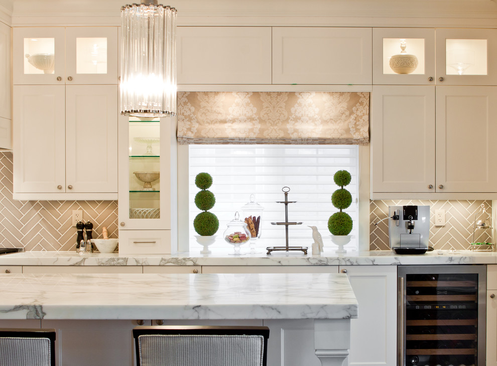 Ornate kitchen photo in Toronto with recessed-panel cabinets, white cabinets, marble countertops, brown backsplash, stainless steel appliances and ceramic backsplash