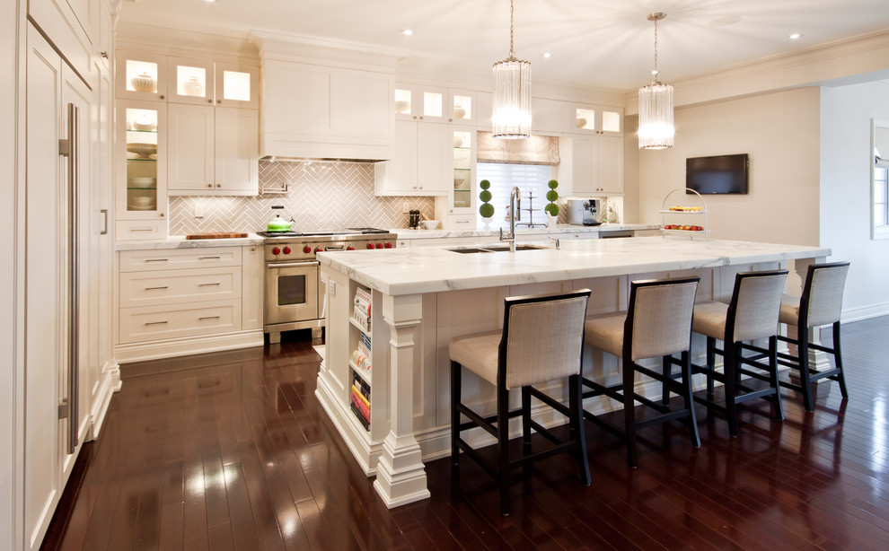 Inspiration for a transitional kitchen remodel in Toronto with recessed-panel cabinets, paneled appliances, marble countertops, white cabinets and gray backsplash