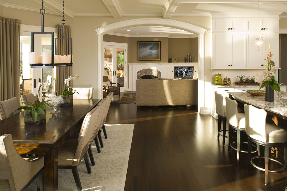 Elegant eat-in kitchen photo in Minneapolis with white cabinets