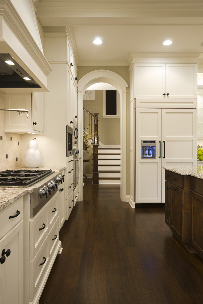 Example of a classic kitchen design in Minneapolis with paneled appliances, recessed-panel cabinets and white cabinets