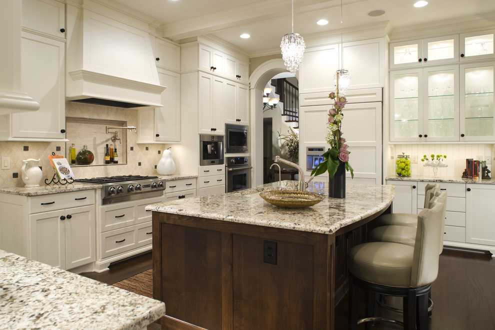 Kitchen - traditional kitchen idea in Minneapolis with recessed-panel cabinets, paneled appliances and white cabinets