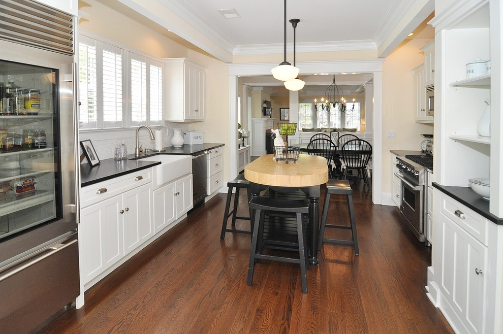 Kitchen - traditional kitchen idea in New York with stainless steel appliances and a farmhouse sink