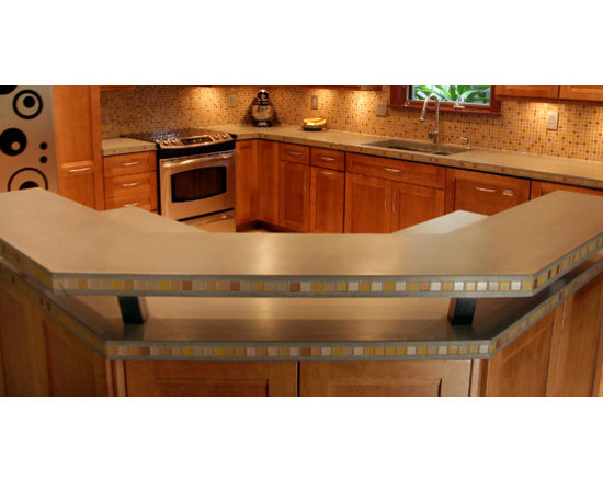Kitchen Surround with Raised Bar - This is a kitchen countertop and surround with a raised bar area. This counter is two inches thick and has a custom edge profile, pricing out at $80 per square foot.