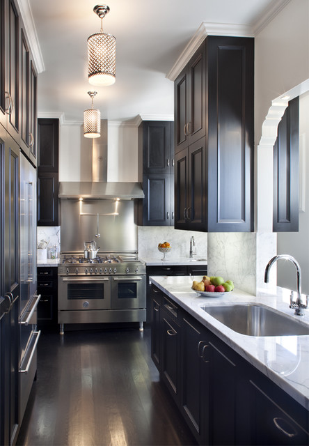 Example of a trendy enclosed kitchen design in San Francisco with a single-bowl sink, recessed-panel cabinets, black cabinets, marble countertops, white backsplash, stone slab backsplash and stainless steel appliances