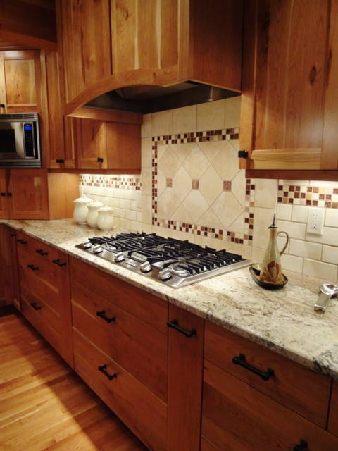 Kitchen tile backsplash ideas traditional kitchen seattle by wyland interior design center Kitchen tile design ideas backsplash