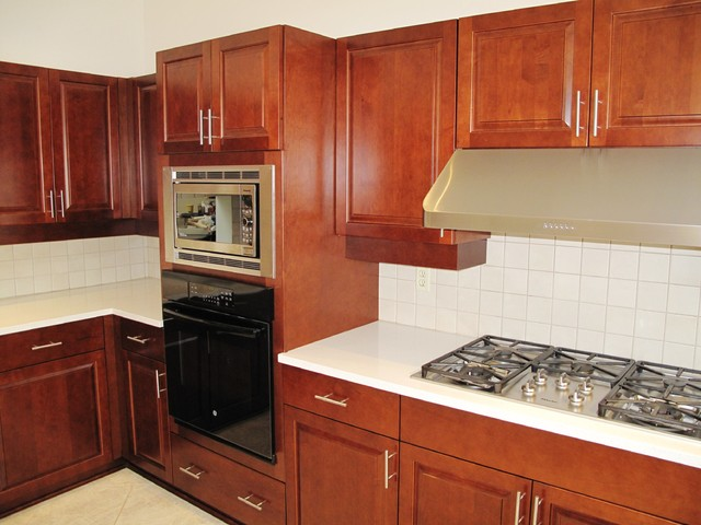 Kitchen Transformation done with Cabinet Refacing in Maple traditional-kitchen