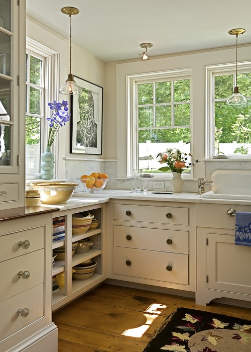 Using antique crystal door knobs as cabinet knobs for Kitchen cabinets that look like furniture