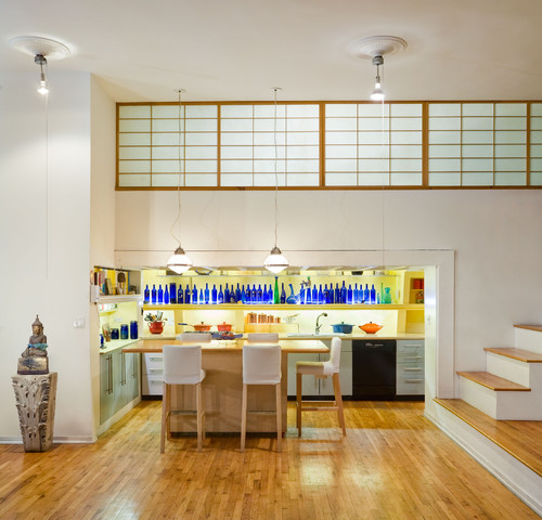 Kitchen with shelf of assorted blue bottle decor