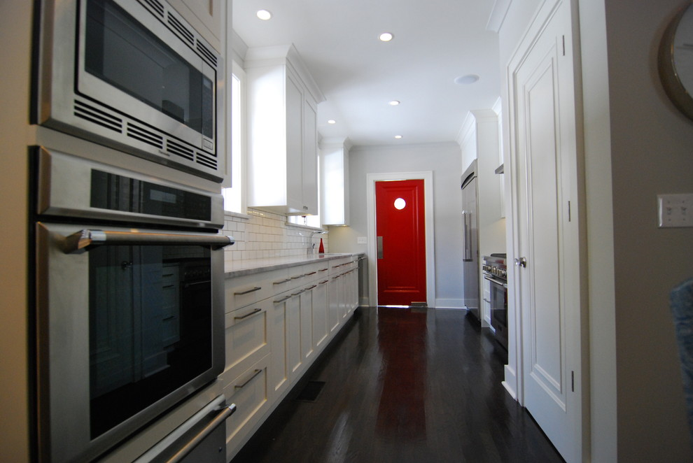 Trendy galley enclosed kitchen photo in Jacksonville with stainless steel appliances