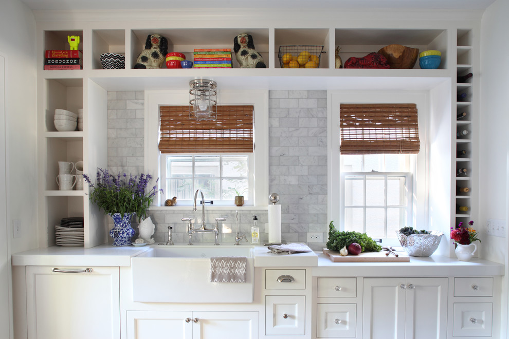 Kitchen - traditional kitchen idea in Minneapolis with a farmhouse sink, open cabinets, white cabinets, white backsplash and marble backsplash