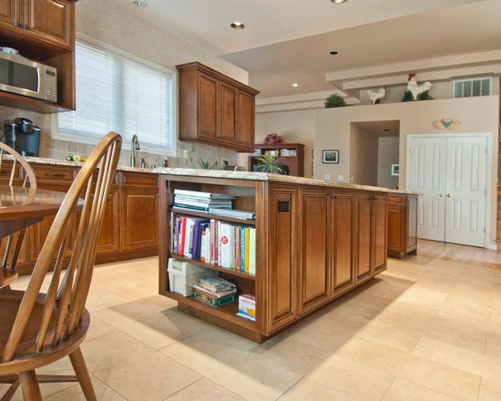 Kitchen Update - Island contains lots of storage drawers and cabinets as well as ample work surface area. Granite counter tops, maple cabinets, soft close door hinges, soft close full extension drawer guides, stainless steel appliances,  Photos By UDCC