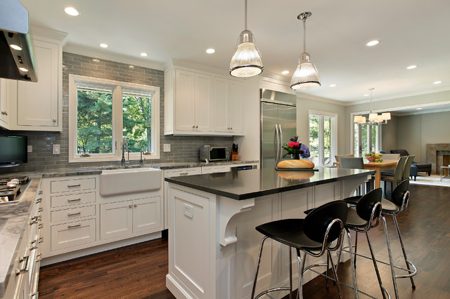 Elegant Kitchen Photo In Chicago With Subway Tile Backsplash, A Farmhouse  Sink And Stainless Steel
