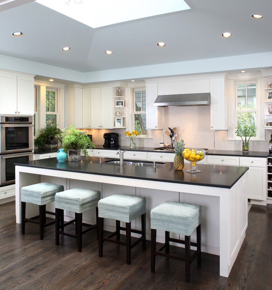 Transitional kitchen photo in DC Metro with stainless steel appliances, a double-bowl sink and white cabinets