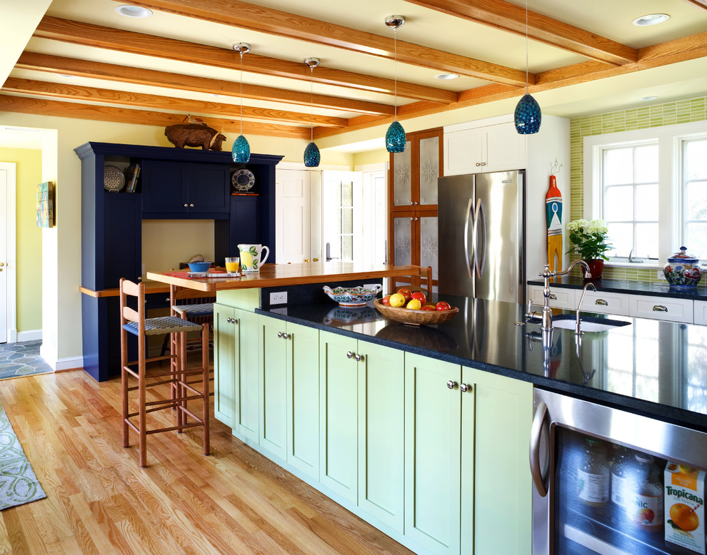 Example of a classic kitchen design in DC Metro with green cabinets