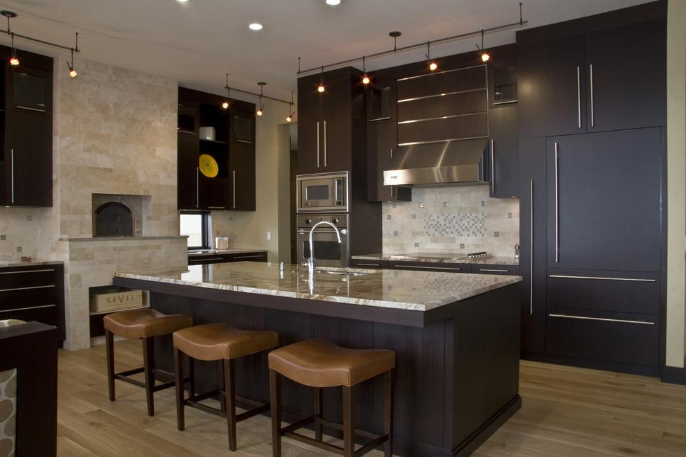 Trendy kitchen photo in Grand Rapids with paneled appliances and limestone backsplash