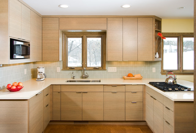 Example Of A Minimalist Kitchen Design In Minneapolis With Stainless Steel Liances