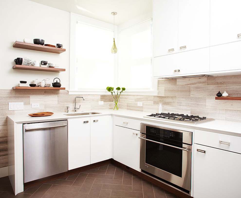 Mid-sized trendy l-shaped ceramic tile enclosed kitchen photo in San Francisco with stainless steel appliances, flat-panel cabinets, white cabinets, quartz countertops, gray backsplash, a single-bowl sink, stone tile backsplash and no island