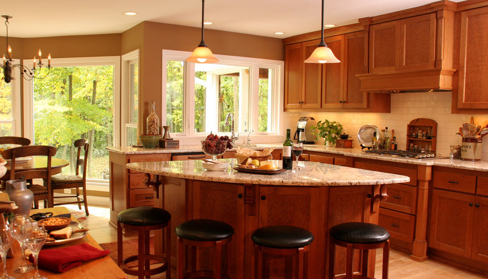 Inspiration for a transitional kitchen remodel in Milwaukee with granite countertops