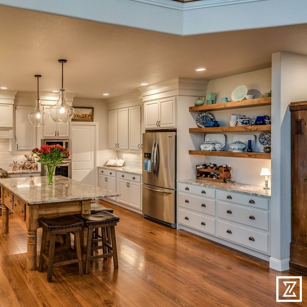 Kitchen with built in cabinetry and floating shelves