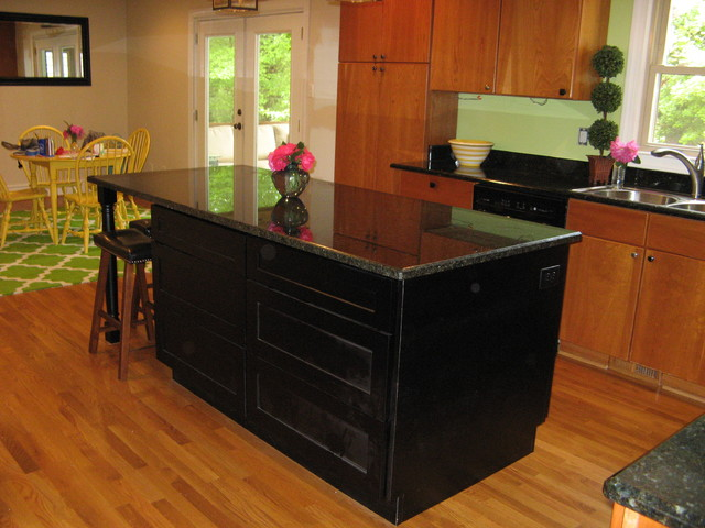 Kitchen with dark cabinets and dark granite transitional kitchen raleigh by cabinets of Kitchen design center raleigh nc