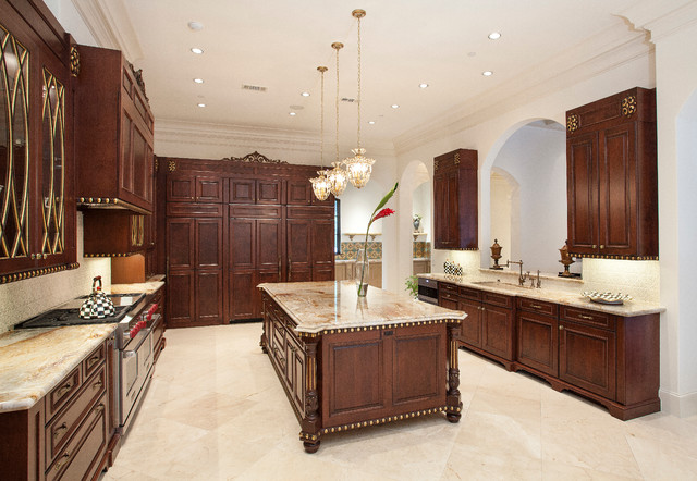Kitchen with large island and gold details traditional for Kitchen island houston