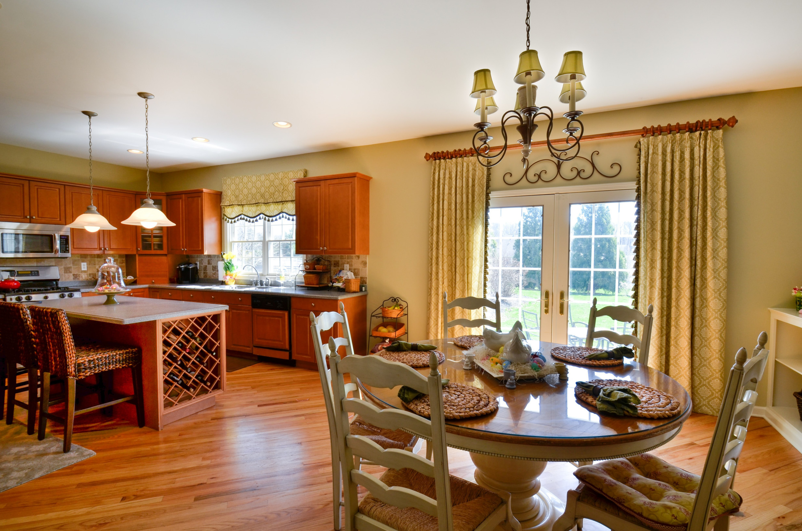 Kitchen with panels and shade with fabric and matching tassel trim.