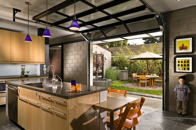 Kitchen with Private Courtyard outside Glass Garage Doors modern-kitchen