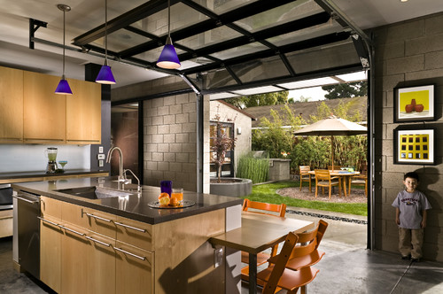 Kitchen with Private Courtyard outside Glass Garage Doors