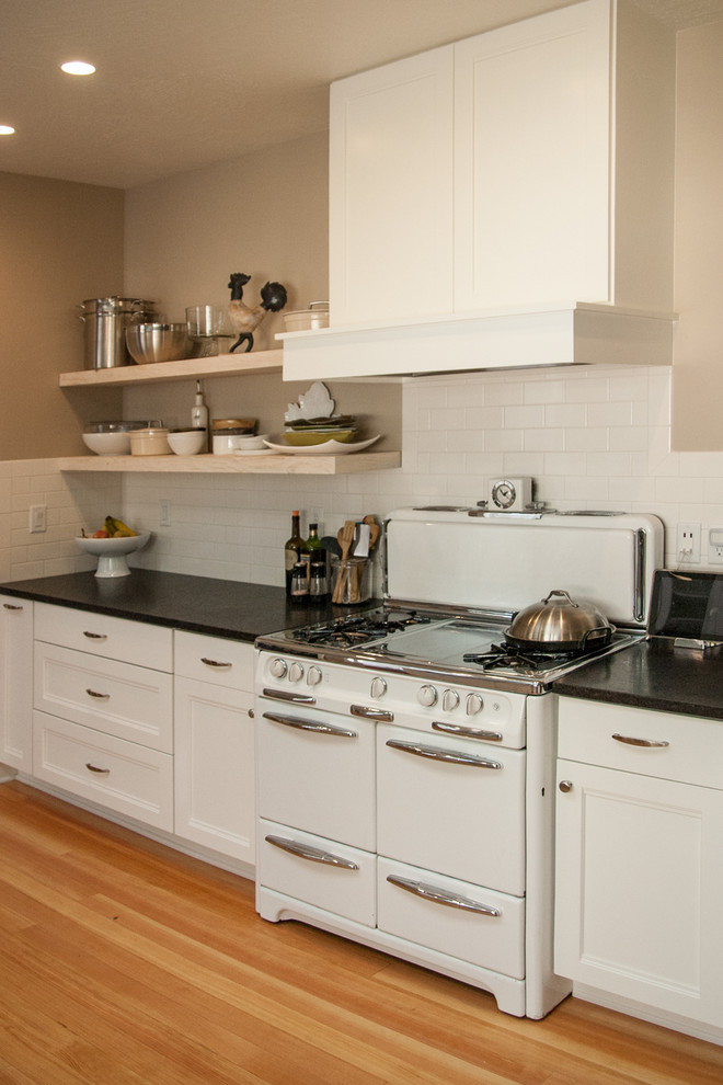 Kitchen with reclaimed wood floating shelves - Oregon ...