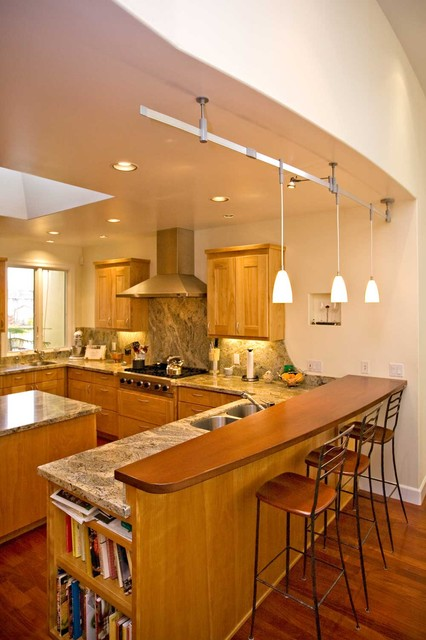 Kitchen with solid wood bar. Curved wall matches curved bar. contemporary kitchen