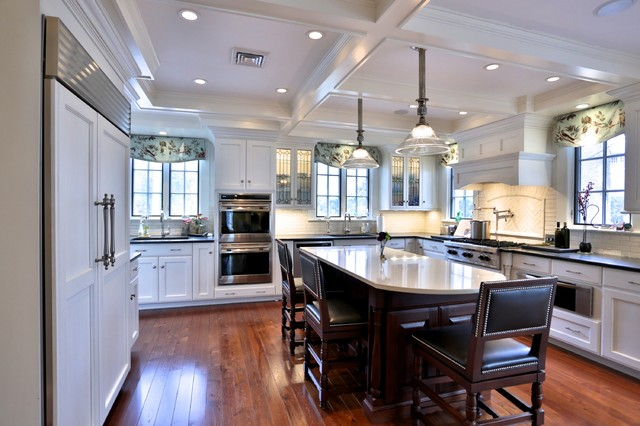 Kitchen With White Cabinets And Coffered Ceiling