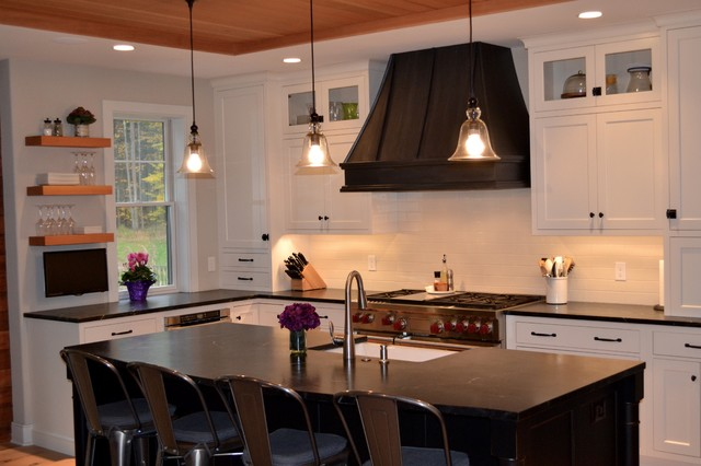 Kitchen with White Cabinets with Black Range Hood ...