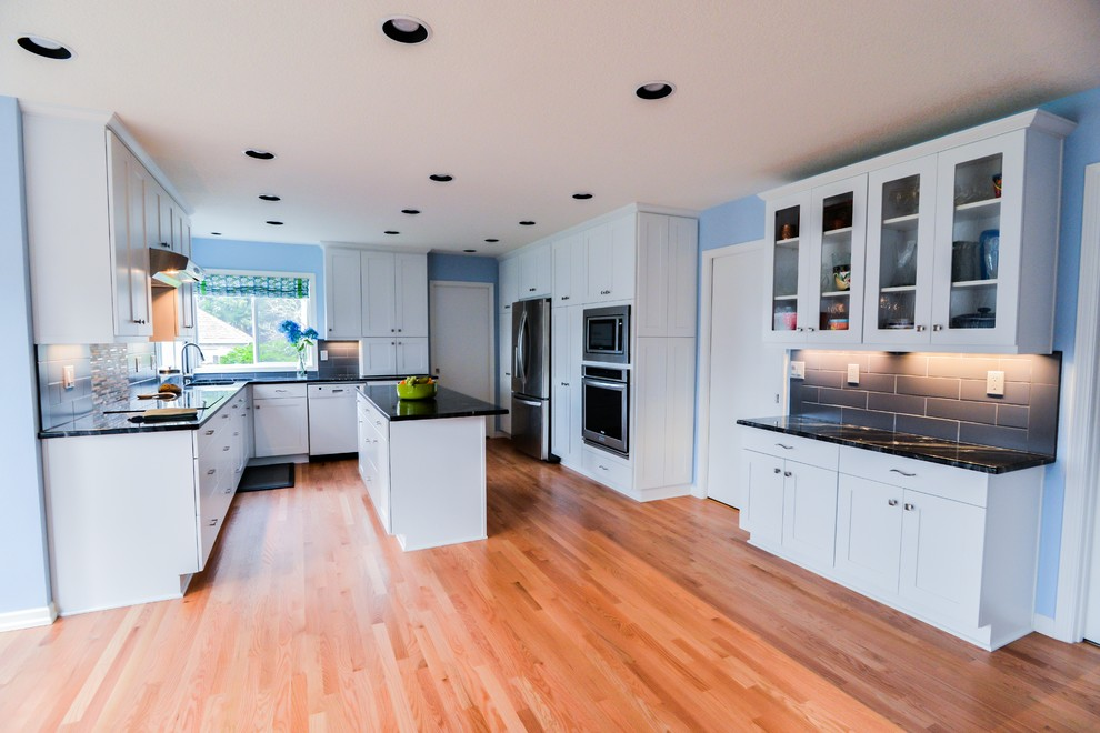 Kitchen with white painted shaker style cabinets ...