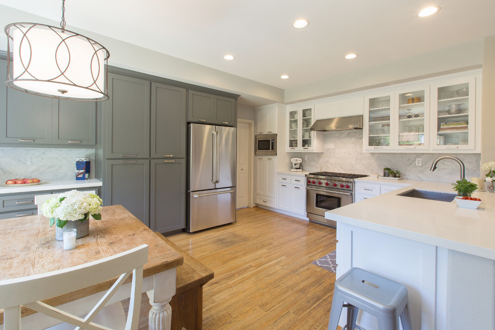 Inspiration for a large kitchen remodel in Sacramento with an undermount sink, shaker cabinets, white cabinets, quartz countertops, white backsplash and stainless steel appliances