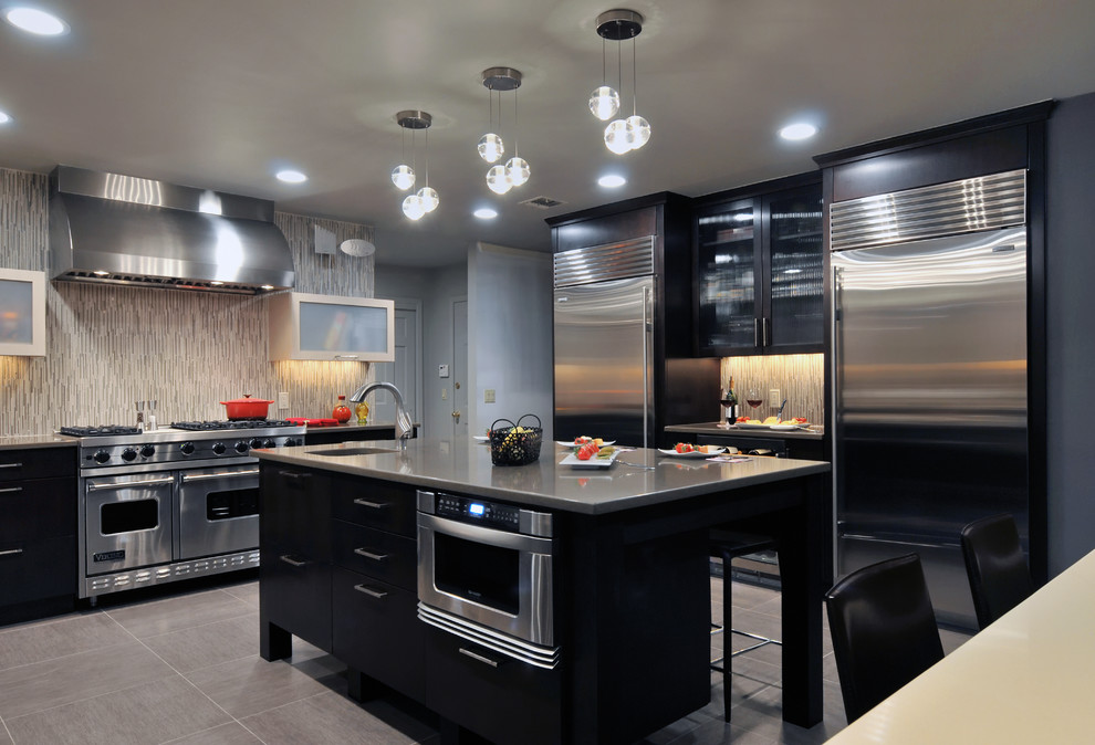 Kitchen - contemporary kitchen idea in New York with stainless steel appliances