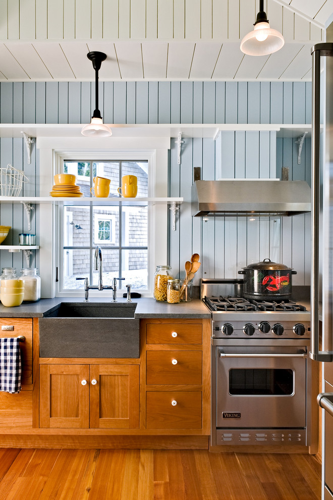 Kitchen - coastal kitchen idea in Portland Maine with stainless steel appliances, a farmhouse sink, shaker cabinets, medium tone wood cabinets and multicolored backsplash