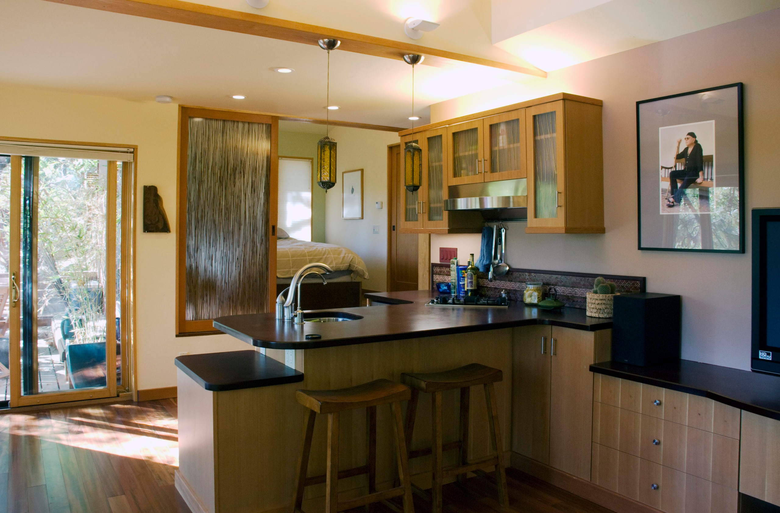 Kitchenette with bedroom beyond